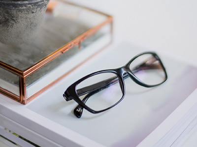 glasses and glass box sitting on desk
